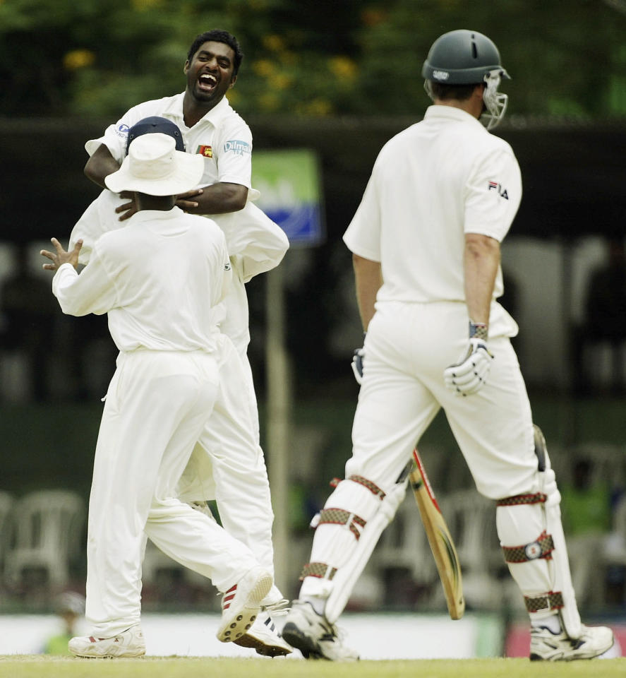 KANDY, SRI LANKA - MARCH 16:  Muttiah Muralitharan of Sri Lanka celebrates his 500th career wicket as he dismisses Michael Kasprowicz of Australia during day one of the Second Test between Australia and Sri Lanka played at Asgiriya Stadium on March 16, 2004 in Kandy, Sri Lanka. (Photo by Hamish Blair/Getty Images)