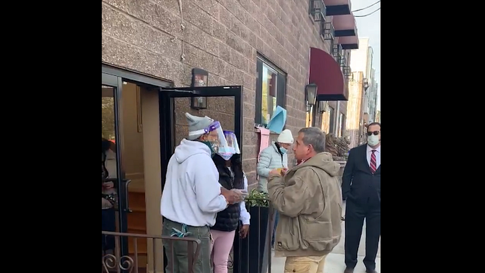 Man talking to election officials outside polling station