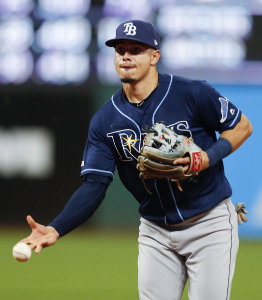 Tampa Bay Rays' Willy Adames throws out Cleveland Indians' Jake Bauers at first base during the eighth inning of a baseball game, Saturday, May 25, 2019, in Cleveland. (AP Photo/Ron Schwane)