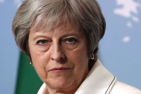 British PM May Denounces Child Migrants in Cages as 'Deeply Disturbing'