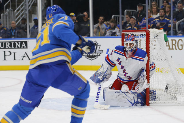 New York Rangers goaltender Henrik Lundqvist, of Sweden, defends a shot from St. Louis Blues' Jacob de la Rose, of Sweden, during the second period of an NHL hockey game Saturday, Jan. 11, 2020, in St. Louis. (AP Photo/Billy Hurst)