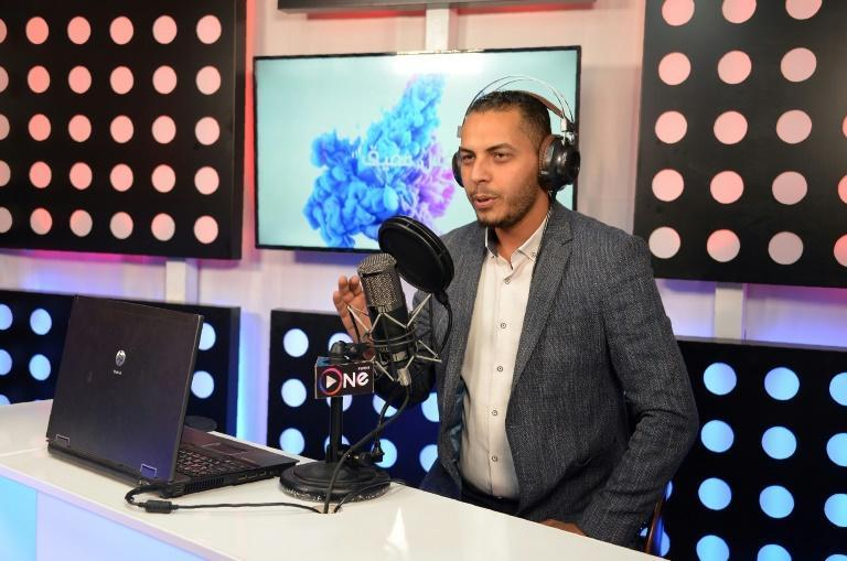 """Radio presenter Ahmad al-Jaffal, 30, says the jihadist occupation """"created a vacuum of thought"""", as radio stations were banned under the Islamic State group's rule in the Iraqi city of Mosul"""