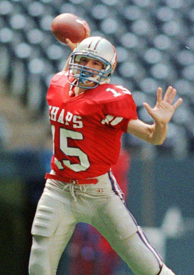 FILE - In this Dec. 21, 1996 file photo, Westlake High School quarterback Drew Brees prepares to pass against Abilene Cooper High School during a football game in Austin, Texas. Ten years after Brees led Westlake High School to victory in the Texas state championship game, Nick Foles broke several of his passing records but lost in the title game. The two quarterbacks meet with far more at stake _ Saints vs. Eagles in an NFC wild-card game. (AP Photo/Austin American Statesman, Ralph Barrera, File)