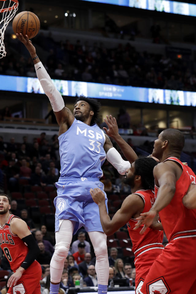 Minnesota Timberwolves forward Robert Covington (33) drives to the basket against the Chicago Bulls during the first half of an NBA basketball game in Chicago, Wednesday, Jan. 22, 2020. (AP Photo/Nam Y. Huh)