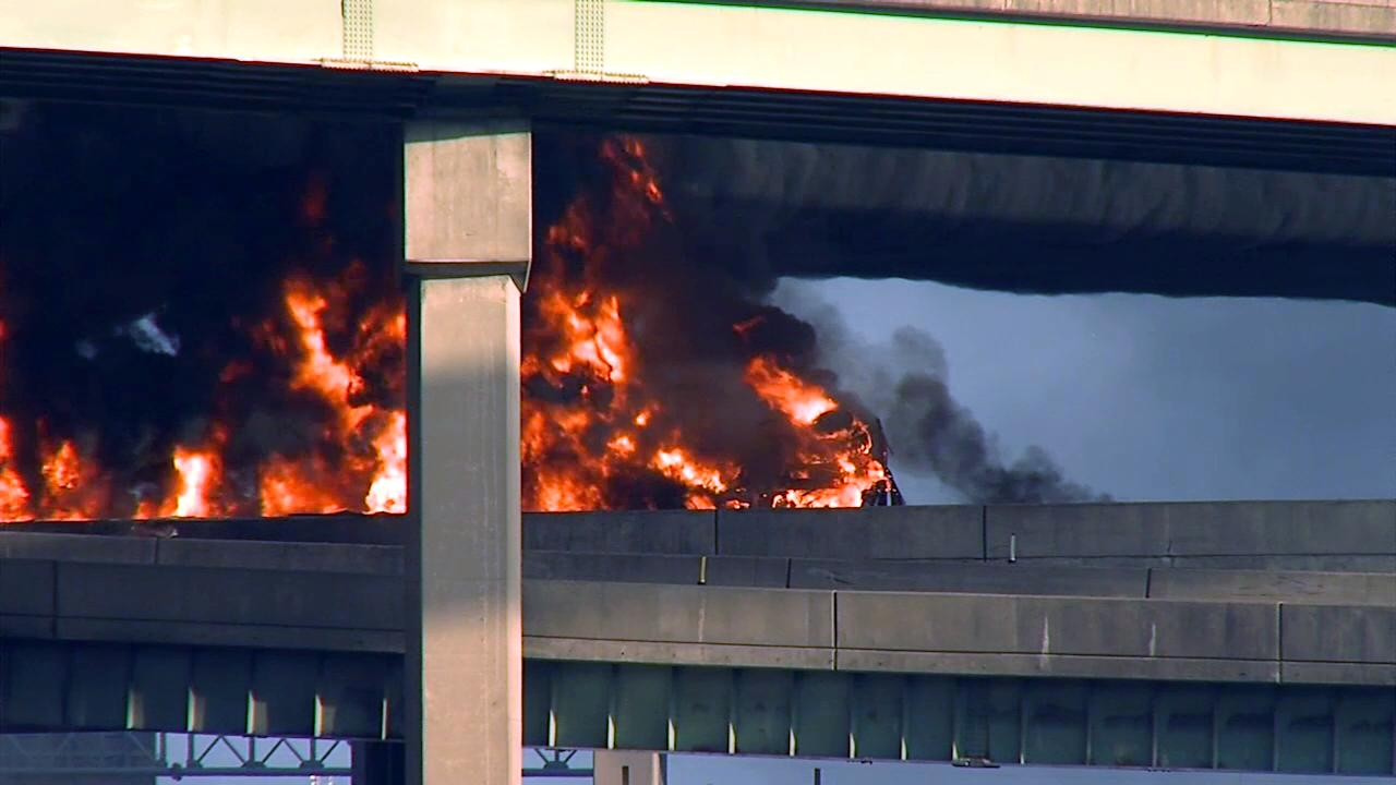 A tanker truck loaded with diesel fuel burns after it overturned along Interstate 81, shutting down the heavily traveled artery near Harrisburg, Pa. on Thursday, May 9, 2013. The truck was headed northbound from Carlisle shortly after 6 a.m. when it flipped over on a ramp to Route 22-322 westbound, near the I-81 bridge over the Susquehanna River. (AP Photo/TV27-David Tristan)