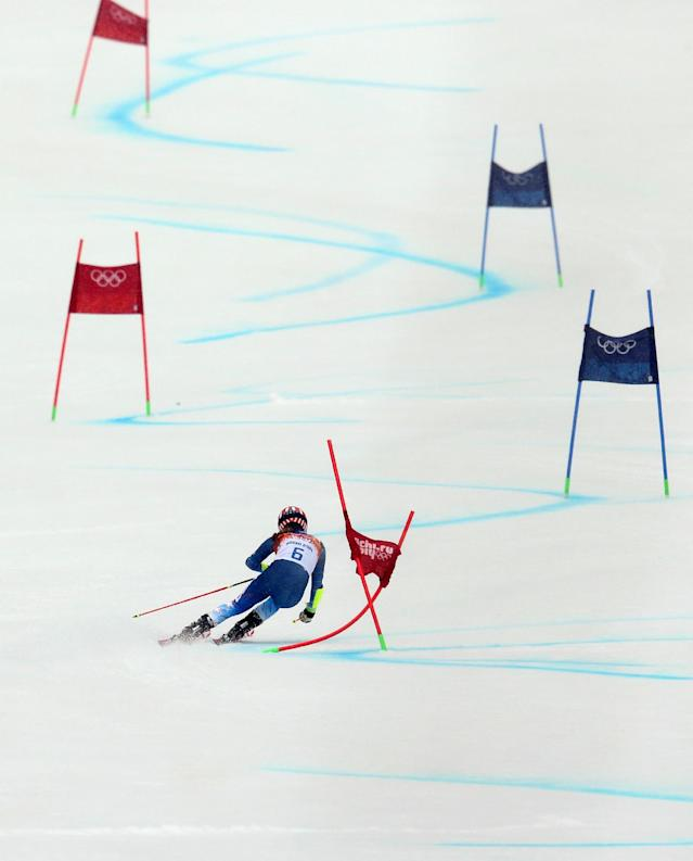 United States' Mikaela Shiffrin passes a gate in the second run of the women's giant slalom at the Sochi 2014 Winter Olympics, Tuesday, Feb. 18, 2014, in Krasnaya Polyana, Russia. (AP Photo/Alessandro Trovati)