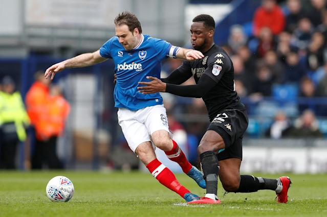 "Soccer Football - League One - Portsmouth vs Wigan Athletic - Fratton Park, Portsmouth, Britain - April 2, 2018 Portsmouth's Brett Pitman in action with Wigan's Chey Dunkley Action Images/Matthew Childs EDITORIAL USE ONLY. No use with unauthorized audio, video, data, fixture lists, club/league logos or ""live"" services. Online in-match use limited to 75 images, no video emulation. No use in betting, games or single club/league/player publications. Please contact your account representative for further details."