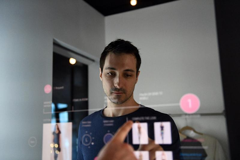 Shoppers will soon be able to tap on an interactive touchable mirror to request a different item of clothing or to seek assistance (AFP Photo/Jewel SAMAD)