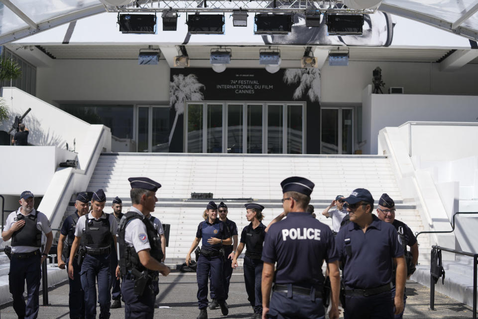 Members of the police are seen in front of the entrance to the Palais des Festival prior to the 74th international film festival, Cannes, southern France, July 5, 2021. The Cannes film festival runs from July 6 - July 17. (AP Photo/ Vadim Ghirda)