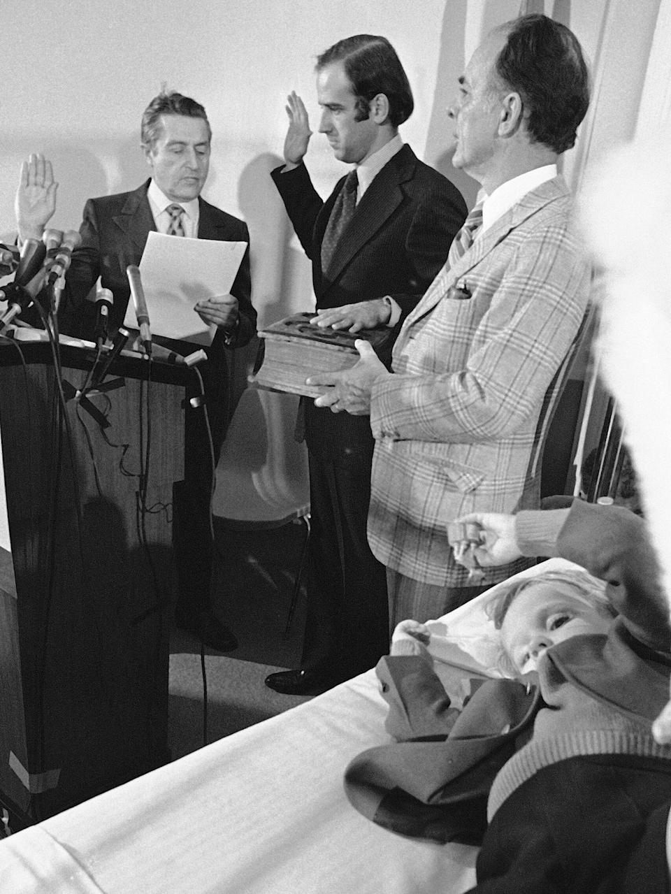 Joe Biden (center) is sworn in as a senator from Delaware at a Wilmington hospital on Jan. 5, 1973.Four-year-old Beau Biden (foreground) was injured in an accident that killed his mother and sister a week before Christmas. His 2-year-old brother, Hunter, was also injured. (Photo: Associated Press)