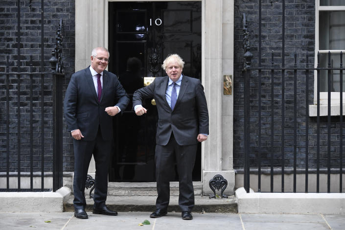 Britain's Prime Minister Boris Johnson, left, greets Australia's Prime Minister Scott Morrison at 10 Downing Street, in London, Monday, June 14, 2021. Johnson and his Australian counterpart Morrison had reached agreement on a free trade deal during negotiations in London, which will be released later Tuesday, June 15, 2021, Australian Trade Minister Dan Tehan said. (AP Photo/Alberto Pezzali)