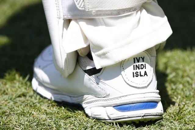 Australia's David Warner has the names of his daughters Ivy Mae, 5, Indy Rae, 3, and Isla Rose, 5 months, embroidered on his shoes as his inspiration during their cricket test match against Pakistan in Brisbane, Australia, Saturday, Nov. 23, 2019. (AP Photo/Tertius Pickard)