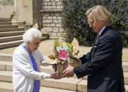 Britain's Queen Elizabeth II receives a Duke of Edinburgh rose, given to her by Keith Weed, President of the Royal Horticultural Society, at Windsor Castle, England, Wednesday June 9, 2021. The newly bred deep pink commemorative rose has officially been named in memory of the late Prince Philip Duke of Edinburgh. A royalty from the sale of each rose will go to The Duke of Edinburgh's Award Living Legacy Fund to support young people taking part in the Duke of Edinburgh Award scheme. (Steve Parsons/Pool via AP)