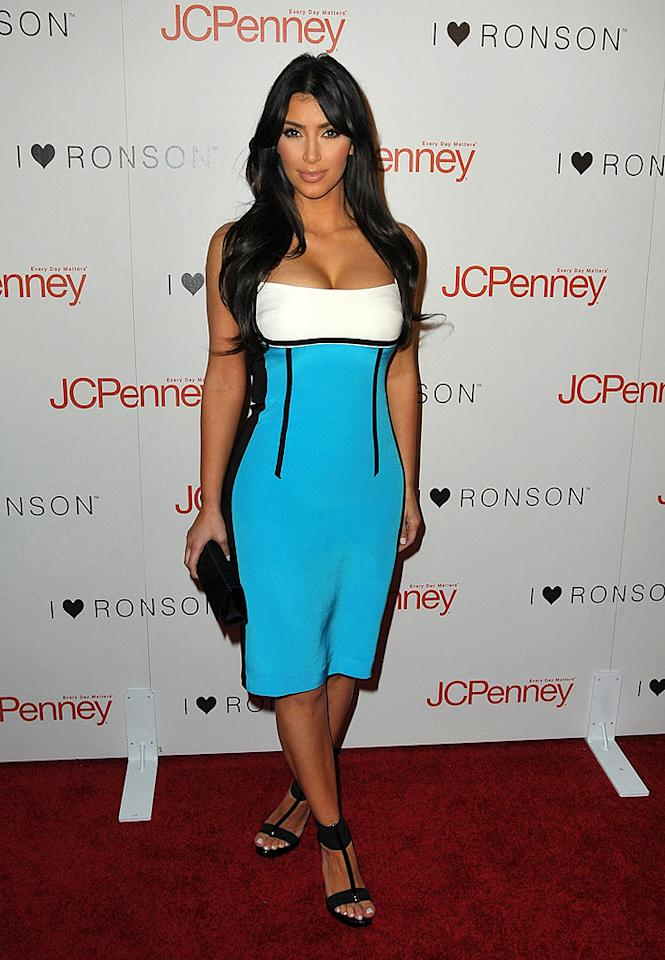 "The stunning Kim Kardashian wowed the crowd in an electric blue-and-white dress and black strappy sandals at the ""I Heart Ronson"" dinner party at Bar Marmont. Jordan Strauss/<a href=""http://www.wireimage.com"" target=""new"">WireImage.com</a> - April 3, 2009"