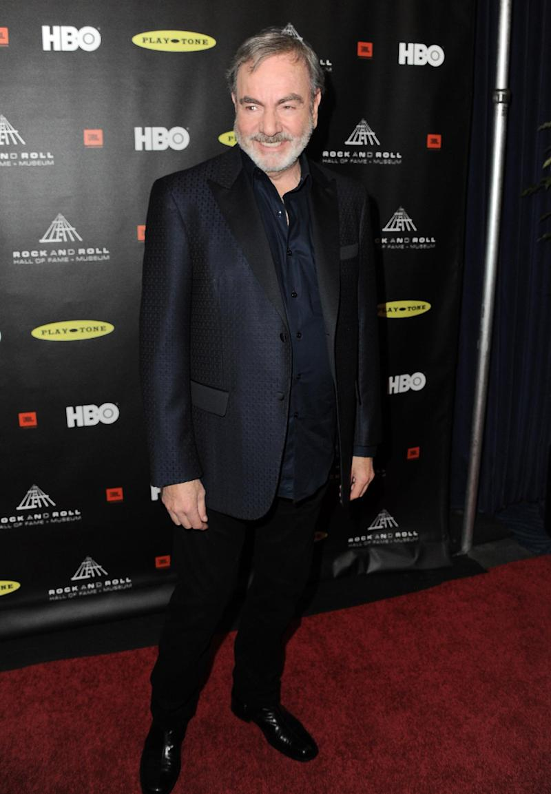 """This Thirsday, April 18, 2013 photo shows Neil Diamond at the Rock and Roll Hall of Fame Induction Ceremony at the Nokia Theatre in Los Angeles. Diamond said he's happy his """"Sweet Caroline,"""" a staple of Boston Red Sox games, can provide comfort after the Boston Marathon bombing. """"There is a lot of comfort that music can offer,"""" Diamond told The Associated Press. """"In this particular situation, I'd much rather it not have happened than for `Sweet Caroline' to become part of it. But it's obviously offering comfort to people and I feel good about that."""" (Photo by Jordan Strauss/Invision)"""
