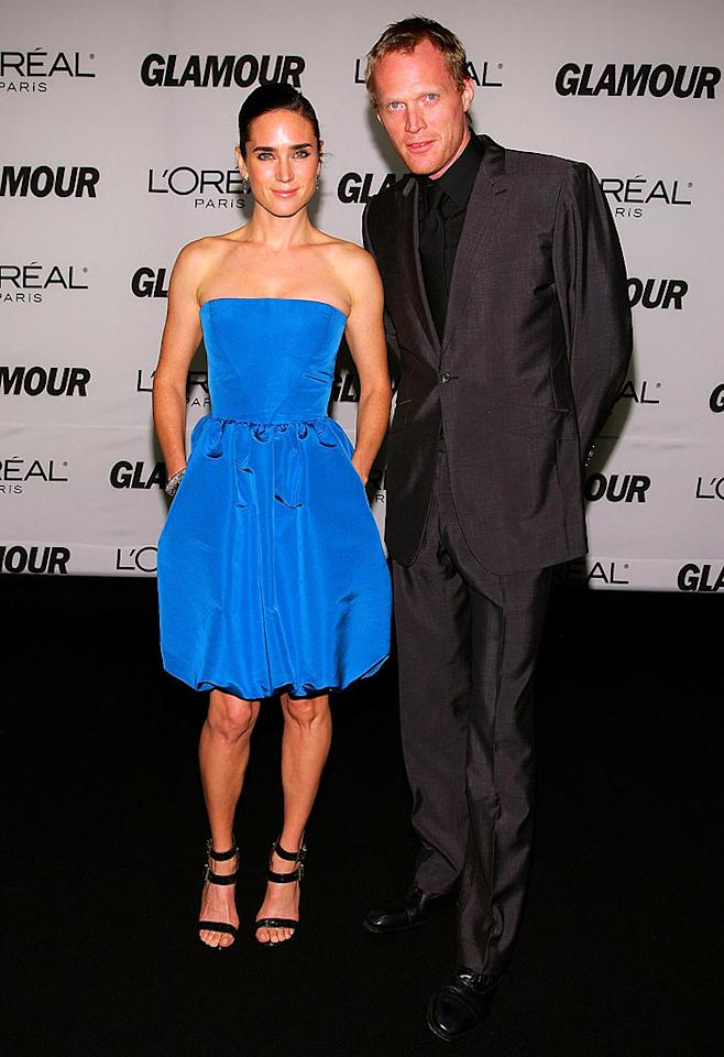 "Cute couple Jennifer Connelly and Paul Bettany keep it simple in solids. Jen opts for a bright blue, strapless cocktail dress while Paul boasts black from head to toe. Dimitrios Kambouris/<a href=""http://www.wireimage.com"" target=""new"">WireImage.com</a> - November 5, 2007"