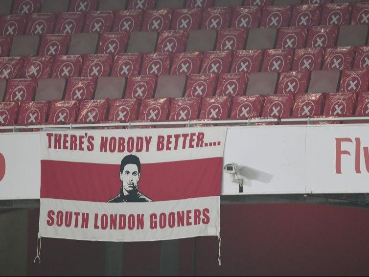 <p>A banner is displayed at the empty Emirates in support of Mikel Arteta</p>Arsenal FC via Getty Images