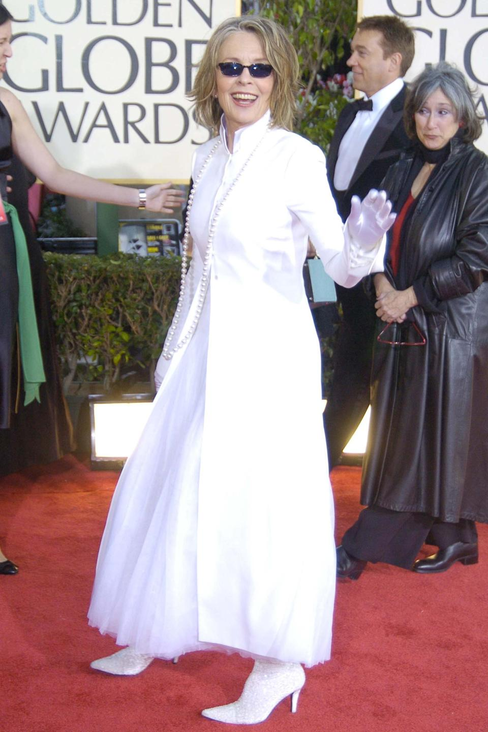 """<strong><h2>2004</h2></strong><br>While this look might not have garnered very much appreciation back in '04, in 2019, we're tipping our hats to the master of menswear, Diane Keaton, for showing up to the Golden Globes donning a collared white coat, itty bitty sunglasses and sequin boots.<br><br><em>Diane Keaton in Nehru-collared white coat. </em><span class=""""copyright"""">Photo: Jeff Kravitz/FilmMagic, Inc.</span>"""