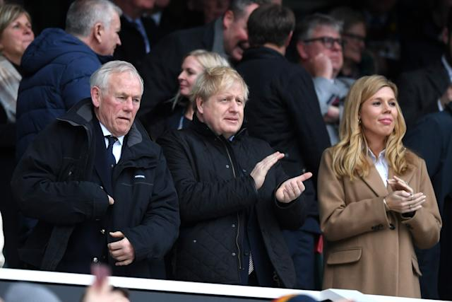 Boris Johnson, pictured with his partner Carrie Symonds in the stands during the 2020 Guinness Six Nations match between England and Wales, is a keen rugby fan. (Photo: Shaun Botterill via Getty Images)