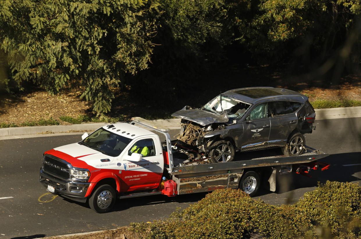 The ruins of Tiger Woods' SUV leave the scene in February. (Carolyn Cole/Los Angeles Times via Getty Images)