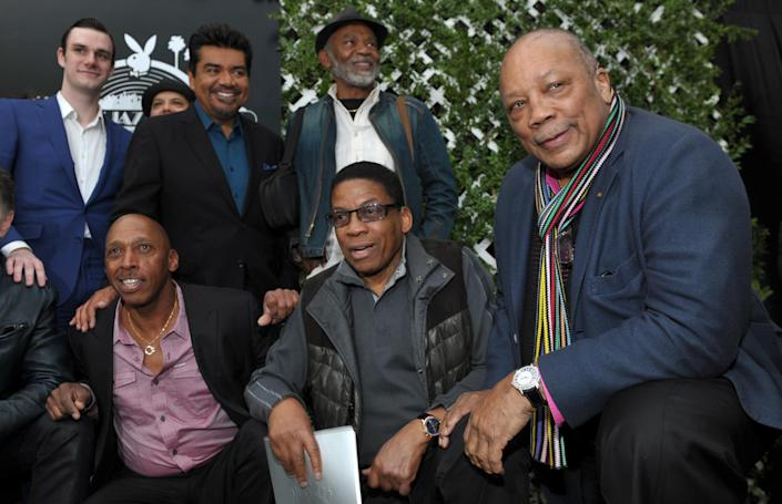 Quincy Jones, right, poses with participants in this year's Playboy Jazz Festival following a news conference at the Playboy Mansion on Thursday, Feb. 28, 2013 in Los Angeles. Clockwise from top left are Playboy Enterprises founder Hugh Hefner's son Cooper, master of ceremonies George Lopez, and musicians Hubert Laws, Herbie Hancock and Jeffrey Osborne. The 35th Anniversary Playboy Jazz Festival will be held at the Hollywood Bowl on June 15 and 16. (Photo by Chris Pizzello/Invision/AP)