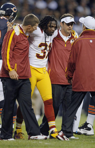 Washington Redskins defensive back Brandon Meriweather (31) is helped off the field after being injured in the first half of an NFL preseason football game against the Chicago Bears in Chicago, Saturday, Aug. 18, 2012. (AP Photo/Charles Rex Arbogast)