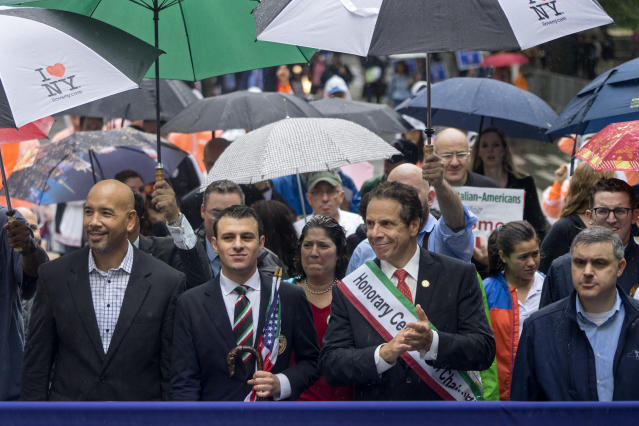 <p>New York Gov. Andrew Cuomo, center right, joins others on 5th Ave. during the annual Columbus Day Parade in New York, Monday, Oct 9, 2017. (Photo: Craig Ruttle/AP) </p>