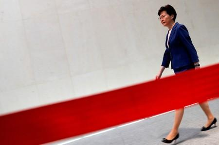 Hong Kong Chief Executive Carrie Lam walks to speaking to media over an extradition bill in Hong Kong