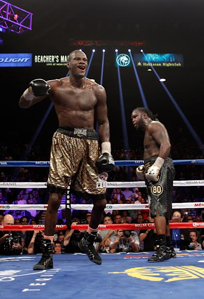 Deontay Wilder, left, celebrates winning the WBC heavyweight title against Bermane Stiverne in January. (Getty)