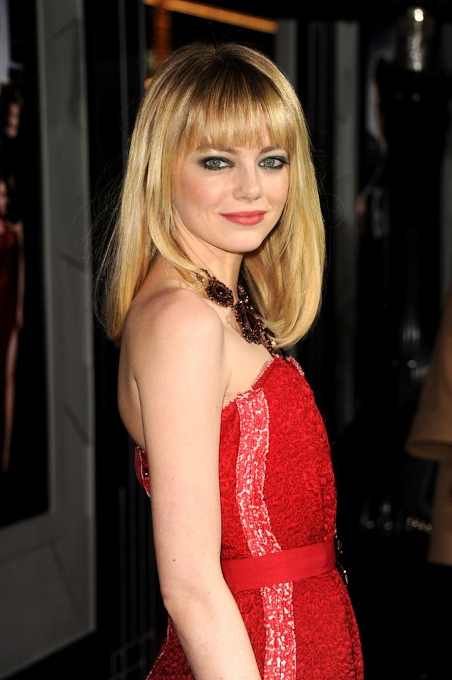 """HOLLYWOOD, CA - JANUARY 07:  Actress Emma Stone arrives at Warner Bros. Pictures' """"Gangster Squad"""" premiere at Grauman's Chinese Theatre on January 7, 2013 in Hollywood, California.  (Photo by Kevin Winter/Getty Images)"""