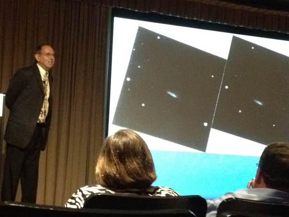 "Amateur astronomer David Levy in front of the two ""discovery"" pictures of Shoemaker-Levy 9. Levy delivered a lecture to a branch of the Royal Astronomical Society of Canada in Ottawa, May 31, 2013."