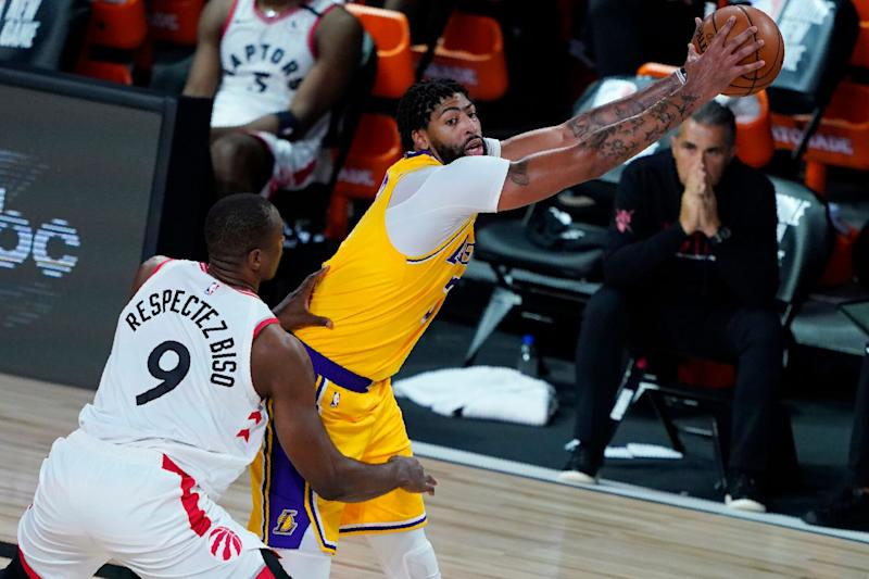 Serge Ibaka posts up against Anthony Davis of the Los Angeles Lakers. (Photo: Pool via Getty Images)