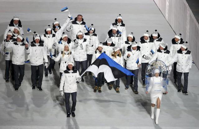 Estonia's flag-bearer IndrekTobreluts leads his country's contingent during the athletes' parade at the opening ceremony of the 2014 Sochi Winter Olympics, February 7, 2014. REUTERS/Lucy Nicholson (RUSSIA - Tags: OLYMPICS SPORT)