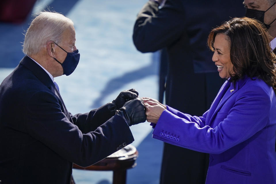 WASHINGTON, DC - JANUARY 20:  U.S. President-elect Joe Biden fist bumps newly sworn-in Vice President Kamala Harris after she took the oath of office on the West Front of the U.S. Capitol on January 20, 2021 in Washington, DC. Biden was sworn in today as the 46th president of the United States. (Photo by Drew Angerer/Getty Images)