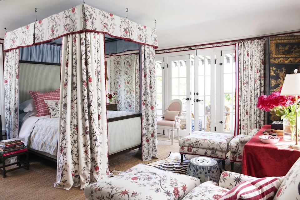 """<p>An iconic tree of life pattern by Braquenié enlivens the walls, upholstery, and bed canopy of a light-filled guest bedroom at designer <a href=""""https://markdsikes.com/"""" rel=""""nofollow noopener"""" target=""""_blank"""" data-ylk=""""slk:Mark Sikes's"""" class=""""link rapid-noclick-resp"""">Mark Sikes's</a> home in Los Angeles. </p>"""
