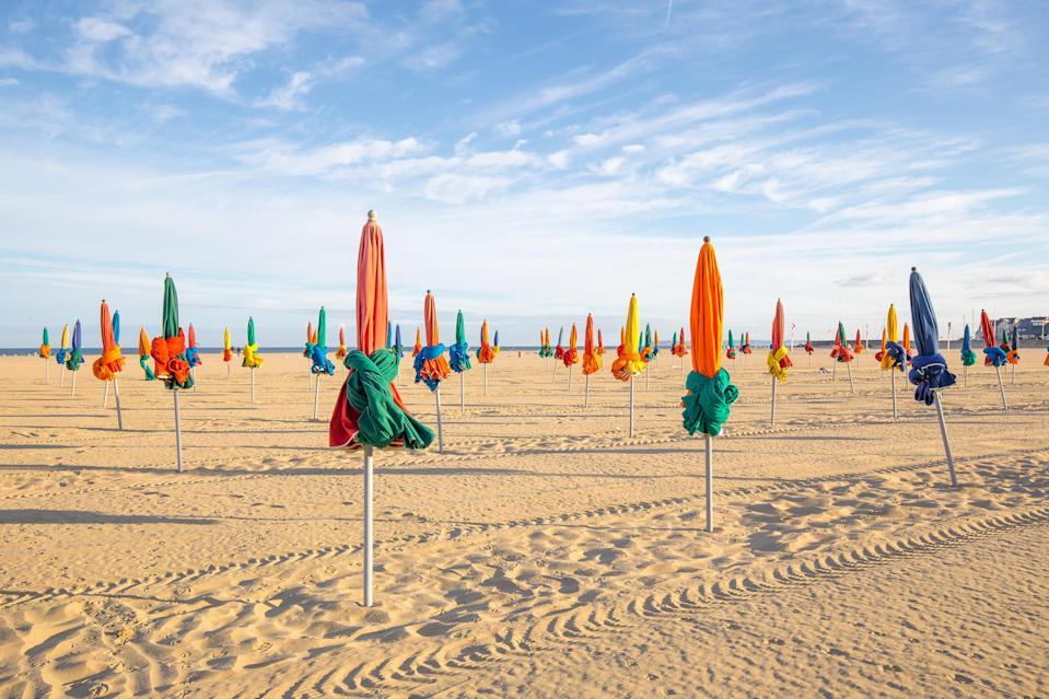The bright beach umbrellas of Deauville (Getty Images)