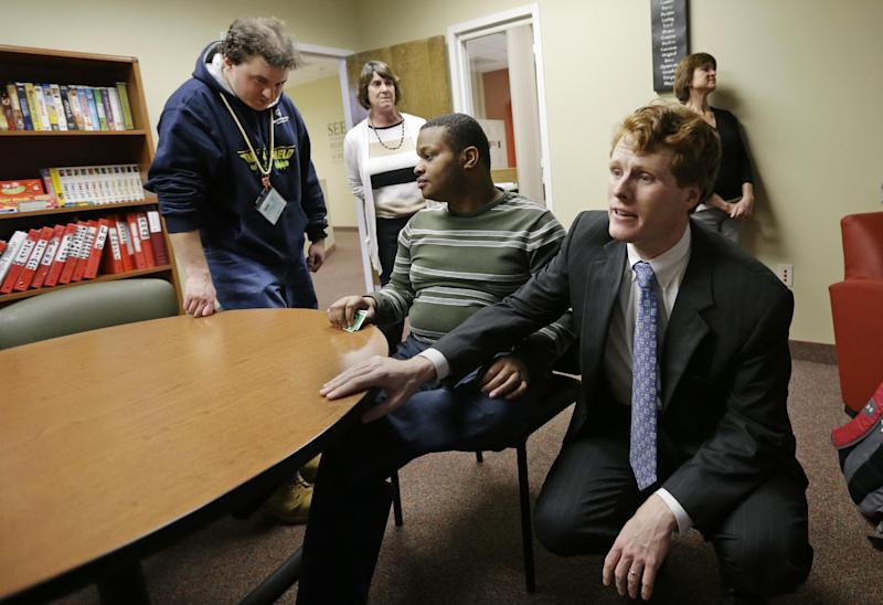 U.S. Rep. Joseph Kennedy III, D-Mass., greets people in the lounge of the Seven Hills Foundation's new facility in Milford, Mass., Monday, Feb. 11, 2013. Seven Hills features the ASPIRE! program for people with developmental disabilities. Kennedy is the grandson of former Attorney General Robert F. Kennedy. President John F. Kennedy is his great-uncle. Both were assassinated more than a decade before he was born. Joe Kennedy says he's working to earn the respect of his colleagues on his own. (AP Photo/Elise Amendola)