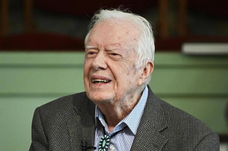 Jimmy Carter teaches Sunday school at Maranatha Baptist Church last week. The former president has been admitted to hospital for treatment of a urinary tract infection: AP
