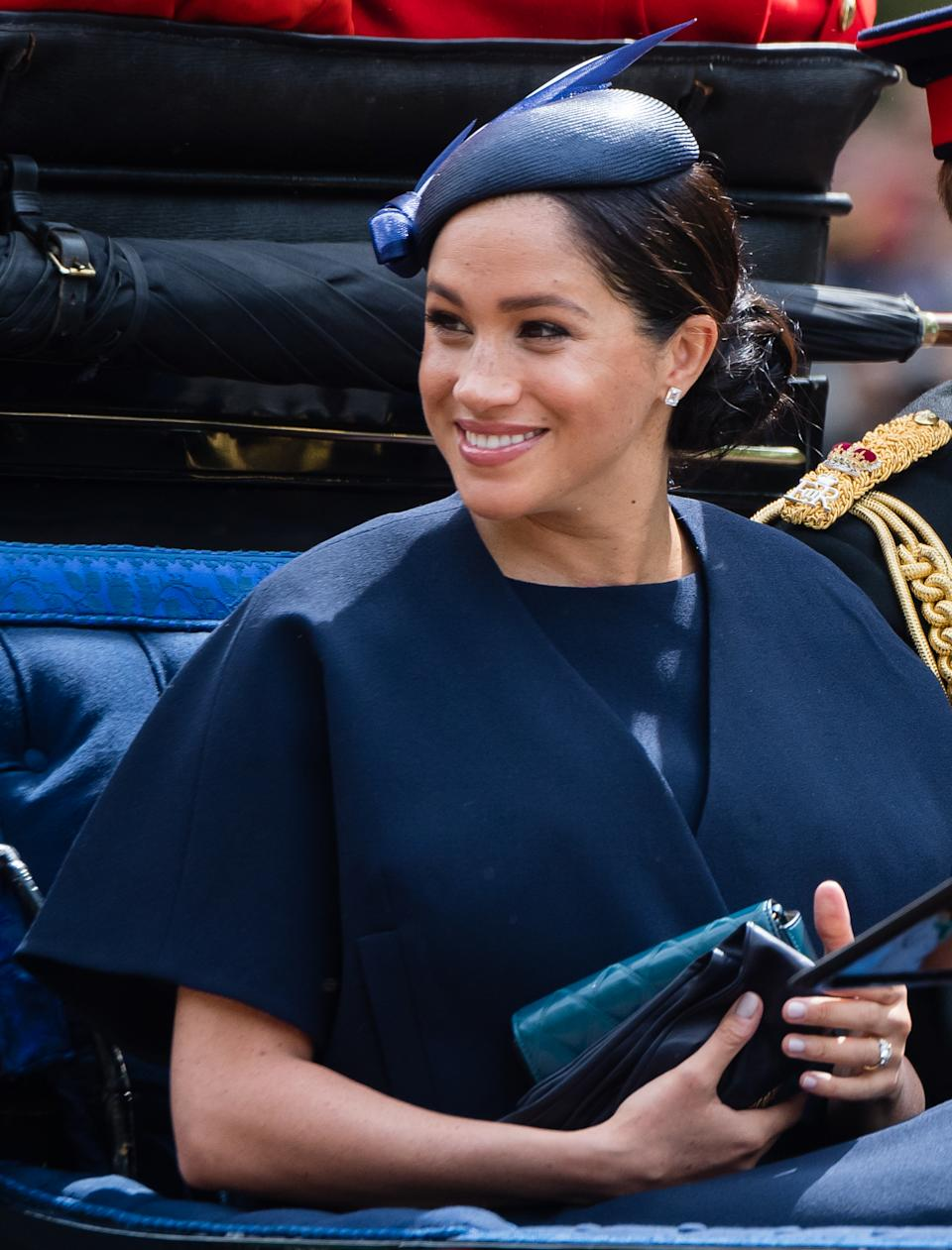 The Duchess of Sussex took a break from maternity leave to join the celebrations and wore a dress by Clare Waight Keller, her wedding dress designer, and a hat by Noel Stewart. (WireImage)