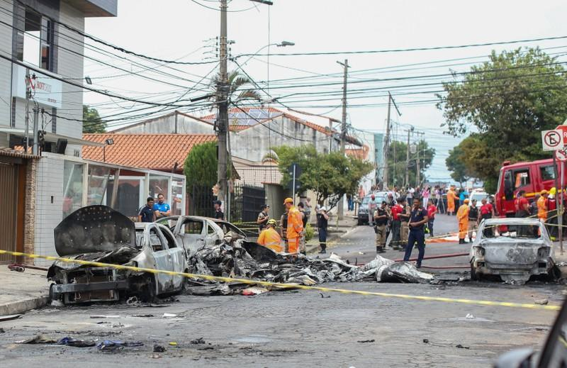 Wrecked cars are seen at the site where a small plane crashed on a residential street in Belo Horizonte