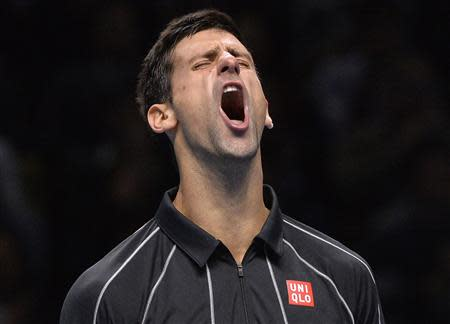 Novak Djokovic of Serbia reacts after breaking the serve of Rafael Nadal of Spain during their men's final singles tennis match at the ATP World Tour Finals at the O2 Arena in London November 11, 2013. REUTERS/Toby Melville