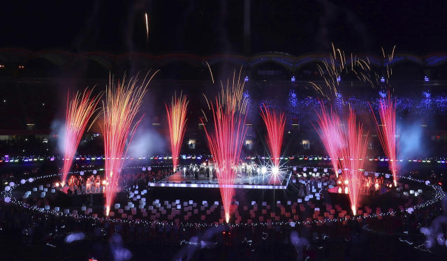 Fireworks go off around a performance stage at Carrara Stadium during the closing ceremony of the 2018 Commonwealth Games on the Gold Coast, Australia, Sunday, April 15, 2018. (AP Photo/Mark Schiefelbein)