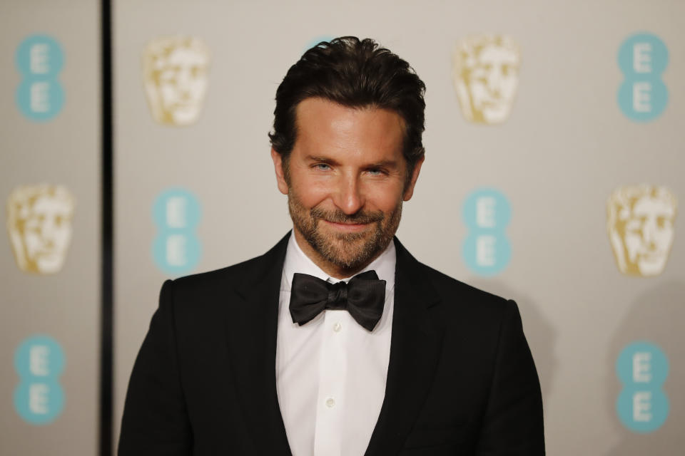US actor Bradley Cooper poses on the red carpet upon arrival at the BAFTA British Academy Film Awards at the Royal Albert Hall in London on February 10, 2019. (Photo by Tolga AKMEN / AFP)        (Photo credit should read TOLGA AKMEN/AFP via Getty Images)