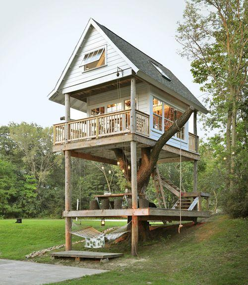 """<p>This is clearly not your average treehouse. A part of <span class=""""redactor-unlink"""">Camp Wandaweg</span>a, the three-story tiny house includes multiple swings and and a library, along with other cool surprises.</p><p><a class=""""link rapid-noclick-resp"""" href=""""https://www.airbnb.com/rooms/2483694"""" rel=""""nofollow noopener"""" target=""""_blank"""" data-ylk=""""slk:BOOK NOW"""">BOOK NOW</a> <strong><em>Camp Wandawega Cabins</em></strong><br></p>"""