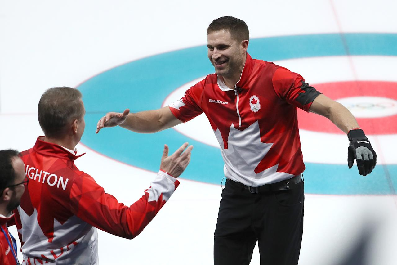 <p>Canada's John Morris celebrates winning the curling mixed doubles gold medal. </p>