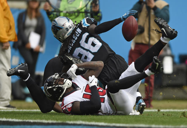 Carolina Panthers' Donte Jackson (26) breaks up a pass to Atlanta Falcons' Calvin Ridley (18) during the first half of an NFL football game in Charlotte, N.C., Sunday, Dec. 23, 2018. (AP Photo/Mike McCarn)