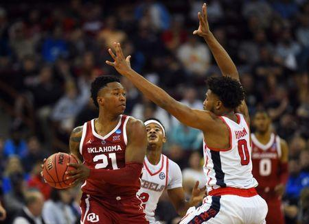 Mar 22, 2019; Columbia, SC, USA; Oklahoma Sooners forward Kristian Doolittle (21) is defended by Mississippi Rebels guard Blake Hinson (0) during the second half in the first round of the 2019 NCAA Tournament at Colonial Life Arena. Mandatory Credit: Bob Donnan-USA TODAY Sports