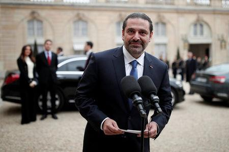 Saad al-Hariri, who announced his resignation as Lebanon's Prime Minister while on a visit to Saudi Arabia, talks to journalists after a meeting with the French President at the Elysee Palace in Paris