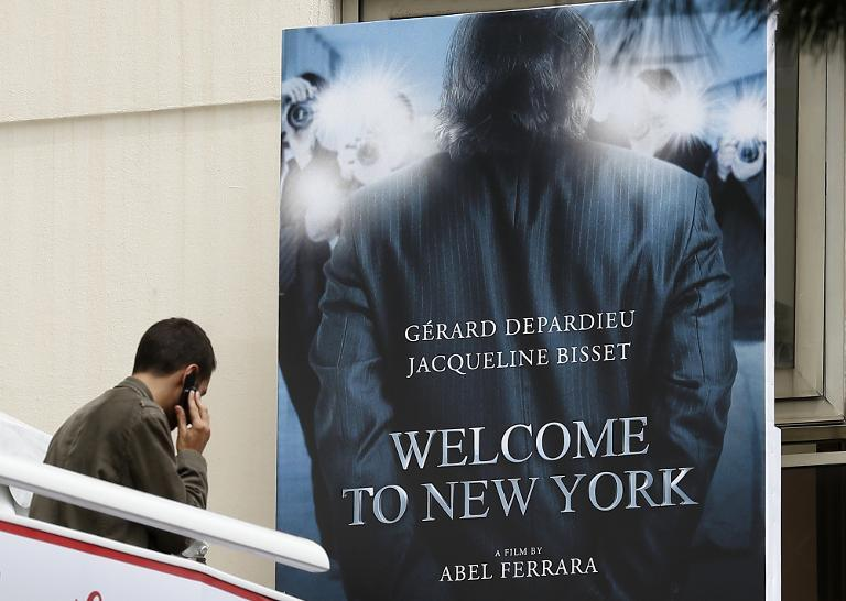"""A poster for """"Welcome to New York"""", the movie inspired by the story of former IMF chief Dominique Strauss-Kahn, in Cannes on May 16, 2013"""
