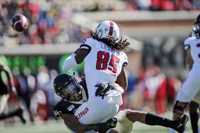 Wake Forest's DeAndre' Delaney causes North Carolina State kick returner Keyon Lesane to fumble in the first half of an NCAA college football game in Winston-Salem, N.C., Saturday, Nov. 2, 2019. (AP Photo/Nell Redmond)